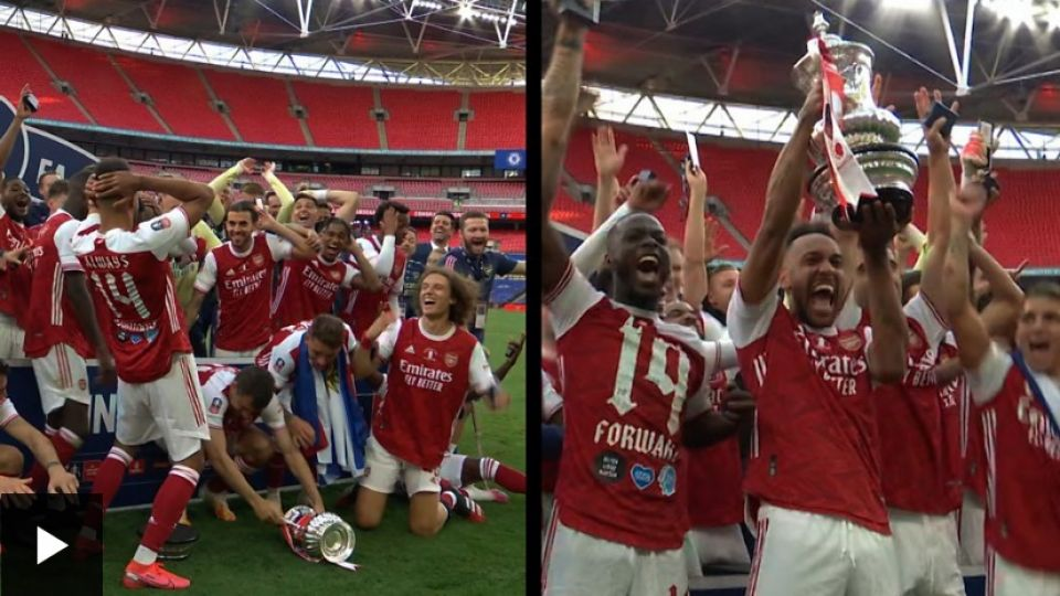 Aubameyang-drops-then-lifts-the-FA-Cup.jpg